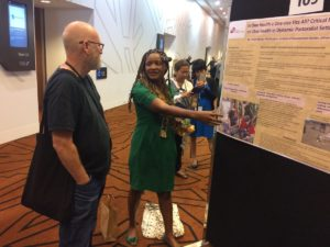 Violet Barasa and poster at One Health EcoHealth 2016