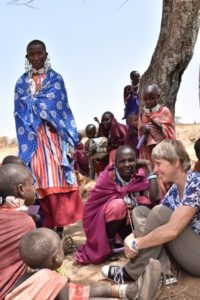 Sarah Cleaveland discussing animal and human health with Maasai pastoralists.